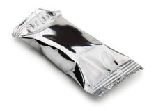 Foil package. Closed food foil package isolated on white Royalty Free Stock Photo