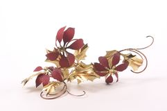 Foil Poinsettias. Wall decorations made of a metal foil imitating poinsettias with gold leaves.  Christmas wall hanging Royalty Free Stock Photos