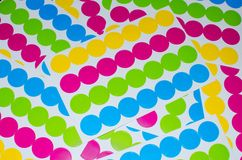 Foil of round multicolored stickers Royalty Free Stock Images