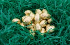 Foil wrapped chocolate Easter candy eggs Royalty Free Stock Photography