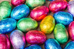 Foil wrapped chocolate Easter eggs. Display of foil wrapped colorful Easter eggs Stock Photo