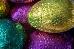 Foil Wrapped Chocolate Easter Eggs. Pile of foil wrapped chocolate Easter eggs Stock Photo