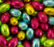 Foil wrapped Easter eggs. Closeup of brightly coloured foil wrapped easter eggs Stock Image