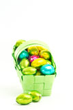 Foil wrapped easter eggs in a basket Stock Photos