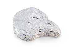 Foil Wrapped Pork Chop. Pork chop wrapped in aluminium foil and on white royalty free stock photo