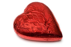 Foil wrapped red chocolate heart Royalty Free Stock Image