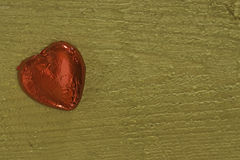 Foil wrapped red chocolate heart Royalty Free Stock Photos