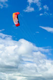 Foilkite high in the air. Showing the foilkite of a kiteboarder high in the air Stock Image