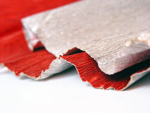Foils. Red and gray foils on white Royalty Free Stock Photography