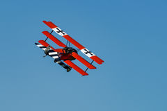 Fokker Dr-I Reproduction. RHINEBECK, NY - SEPTEMBER 25, 2016: The Aerodrome Air Show Team perform a show with the World War I plane Fokker Dr-I Reproduction at royalty free stock image
