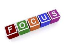 Fokus in farbigen Blockschrift Stockbild