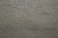 Fokussierte Beschaffenheit der körnigen lauten grauen Wand Lizenzfreies Stockfoto