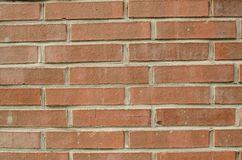 Fokussierte Beschaffenheit der orange festen Backsteinmauer Lizenzfreie Stockfotografie