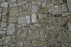 Fokussierte Beschaffenheit des Steinbodens mit Schmutz herum stockbild