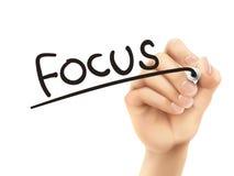 Fokuswort geschrieben durch Hand 3d Stockbilder