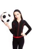 Folâtre la fille avec un football Photographie stock