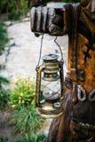 Folclore details. kerosene lamp in hands. Kerosene lamp in hands close up Stock Image