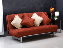 Fold able sofa bed. A luxury comfortable and fold able sofa bed with cute cushions royalty free stock image