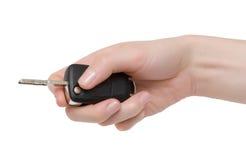Fold car key in hand. Fold car key in female hand. Isolation Stock Photo