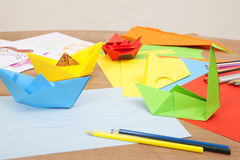Fold colorful paper. Colorful paper lying on a table to fold of objects Stock Photos