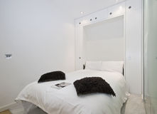 Fold down bed. Of a modern studio apartment Stock Photography