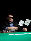 Fold in poker with two aces. Stylish man in black suit folds two aces in casino poker at Las Vegas royalty free stock images