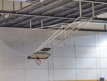Foldable basketball hoop in the high school gym. Safety nets