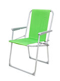 Foldable chair. Green foldable camp chair isolated on white Stock Images