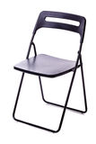 Foldable chair over white. A black plastic foldable chair isolated over a white background Stock Photos