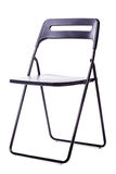 Foldable chair on white. A black plastic foldable chair isolated over a white background Royalty Free Stock Image
