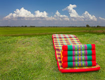 Foldable fields. Foldable corrugated triangular pillow to rest near the fields Stock Photos