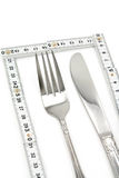 Foldable Tape Measure and fork. With white background, concept of diet Stock Image
