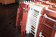 Foldable wooden chairs. Sitting against each other Stock Images