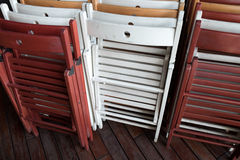 Foldable wooden chairs. Sitting against each other Royalty Free Stock Photography