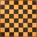 Foldable Wooden Chessboard. Old scratched foldable wooden empty chessboard Royalty Free Stock Images