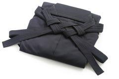 Folded aikido hakama , japanese martial arts unifo. Rm , on white background royalty free stock photography