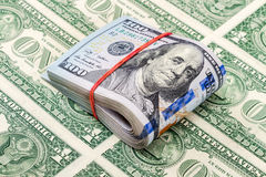 Folded american dollar bills wrapped by rubber band Stock Photography