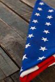 Folded American flag on wooden table Royalty Free Stock Photos