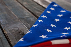 Folded American flag on wooden table Stock Images