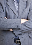 Folded arms. A close up shot of a business man standing with folded arms filling the entire frame of the photo Stock Images