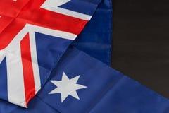 Folded Australian flag on black Royalty Free Stock Photo