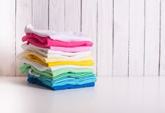 Folded baby clothes royalty free stock image