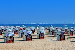 Folded beach chairs on Baltic Sea Royalty Free Stock Photo