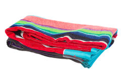 Folded beach towel. Cpolorful folded beach towel isolated on white background Stock Photo