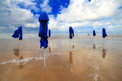Folded beach umbrellas Stock Photos
