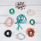 Folded beads of different gemstones stock photography