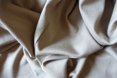 Folded beige viscose and polyester fabric. Folded simple beige viscose and polyester fabric Stock Photos