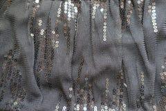Folded black polyester net-like spangled textile Stock Photography