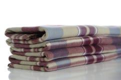 Folded blanket. Accurately folded warm blanket against the white background Royalty Free Stock Photo