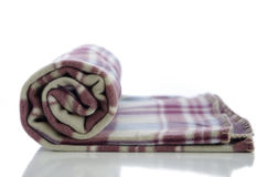 Folded blanket. Accurately folded warm blanket against the white background Stock Photography
